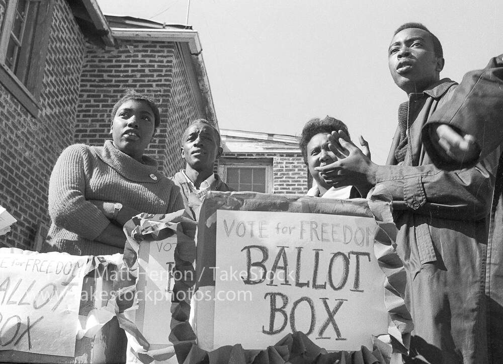 A photograph of SNCC organizers at a polling station in Greenwood for COFO's mock election. Ida Mae Holland is farthest left, October 1, 1963,  Matt Herron, Take Stock